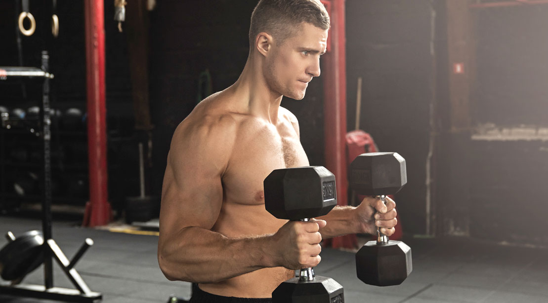 Muscular man doing arm exercises with a hammer curl