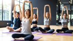Female-Asian-Yoga-Instructor-For-A-Yin-Yoga-Group-Class