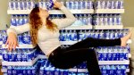 Female UFC fighter Miranda Maverick drinking a bottle of Northern Chill Water