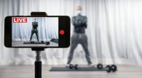 Fitness-Trainer-Live-Streaming-A-Workout-On-His-Iphone