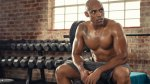 Sweaty Black Man resting on a bench after a hard workout