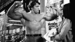 Young Arnold Schwarzenegger flexing his biceps