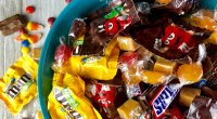 A bowl full of chocolate candies and Mars chocolates