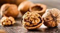 Healthy shelled walnuts on a wooden table