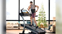 Man running on a nordictrack commercial 22i treadmill in a luxury apartment