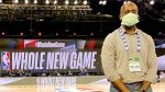 Orthopedic surgeon for the National Basketball Association Benedict Nwachukwu wearing a face mask inside a NBA basketball court and the NBA bubble,Walt Disney World Resort