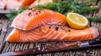 Healthy raw salmon filet with a lemon that helps lower your blood sugar levels