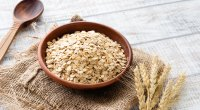 Oatmeal granola a healthy food that lowers blood sugar levels in a wooden bowl