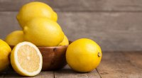 Healthy whole lemons stacked in a bowl and used to lower blood sugar levels