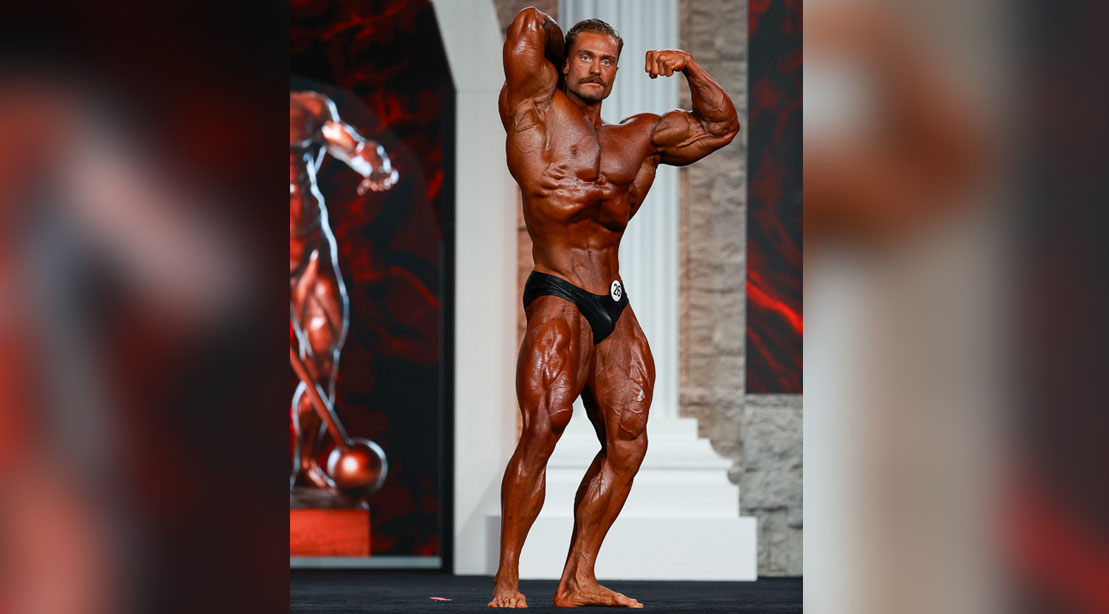 Bodybuilder Classic Physique winner Chris Bumstead posing at the Mr Olympia 2020 event