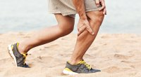 Man suffering from a nutrient deficiency and having a muscle cramp and muscles twitching in his calf muscle