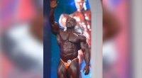 Professional bodybuilder Dexter Jackson waving at his final Olympia bodybuilding compeittion