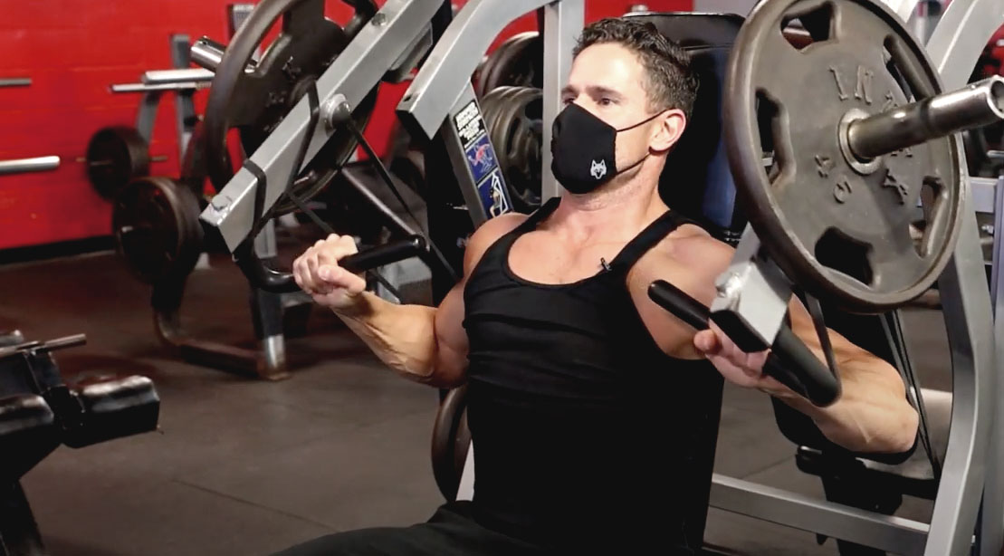 Don Saladino performing a chest workout with a seated machine chest press