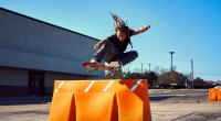 Pro-Skateboarder-Neen-Williams-Jumping-Over-Street-Partition