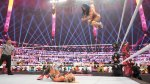 WWE woman wrestler Sasha Banks jumping from the top rope in the squared circle