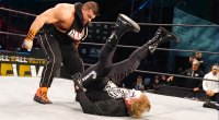AEW wrestling star Brian Cage performs a power bomb wrestling move on Sting