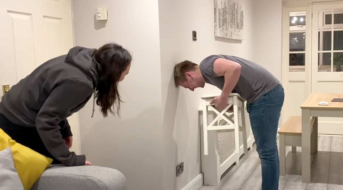 Male and female couple trying the Chair Challenge