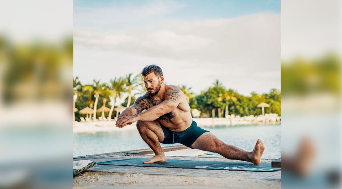 Mat Fraser recently retires from crossfit games and does stretches on the beach