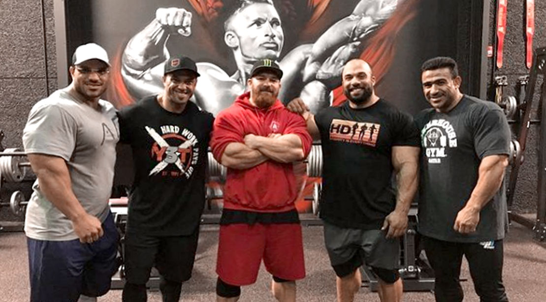 """Bodybuilder Flex Lews """"The Welsh Dragon"""" standing with other bodybuilders in his new gym in Las Vegas """"The Dragon's Lair"""""""