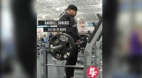 David Baye working out his shoulder muscles with a barbell shrug exercise