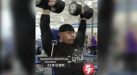 David Baye performs a seated dumbbell press exercise for his shoulder blast workout routine