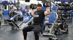 Former NPC bodybuilder David Baye showing how to do a seated dumbbell press exercise