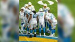 NFL-Rookie-Quarter-Back-Justin-Herbert-In-A-Huddle-On-A-Football-Field