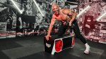 Owner Noah Neiman doing a dumbbell row exercise in his boxing gym