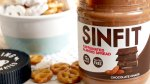 A jar of SINFIT Nutrition Chocolate Chaos Almond Spread