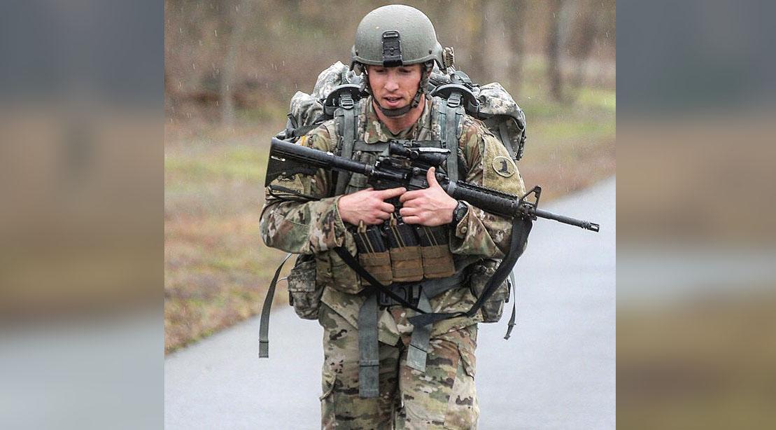 SSG Stephen K Bart hiking with an AR-15