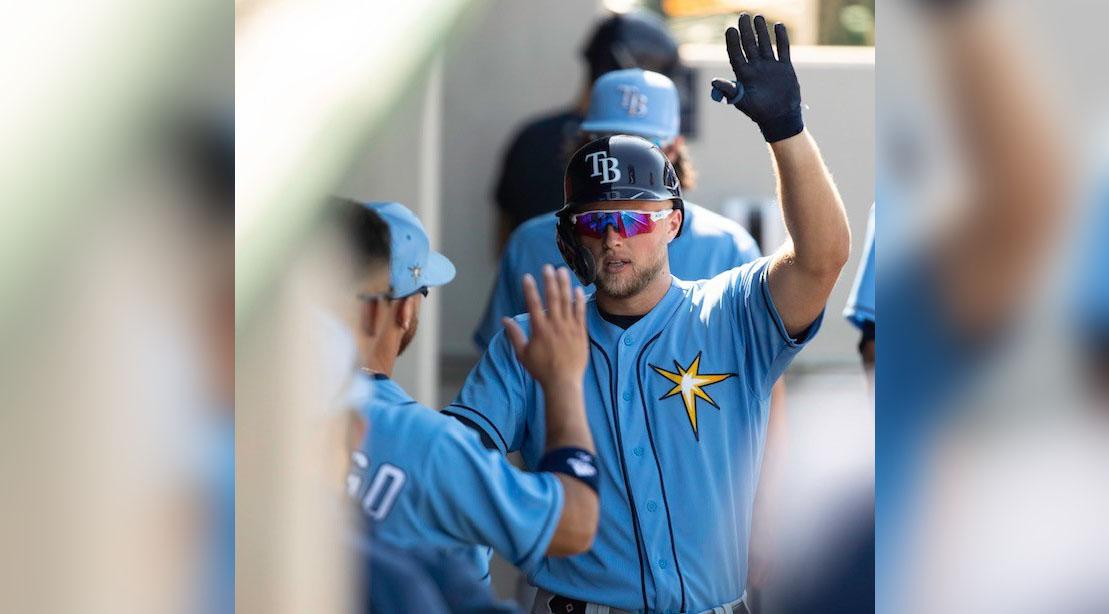 Tampa Bay Devil Rays baseball player Austin Meadows high five his baseball teammates