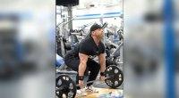 David Baye demonstrating how to do a deadlift exercise