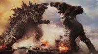 Godzilla Vs King Kong fighting on a military base