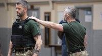 Jon Stratford Holding A Student Shoulder