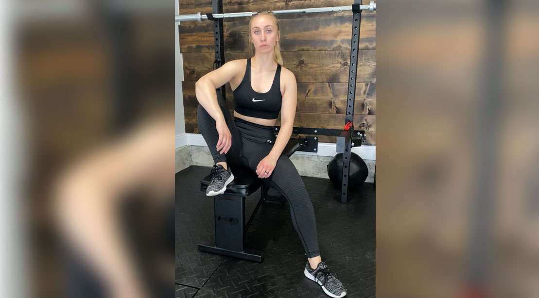 Libby Fleming Sargent sitting on a barbell bench for her Minimal Equipment Full Body Circuit Crusher Fleming Sargent sitting on a barbell bench for her Minimal Equipment Full Body Circuit Crusher