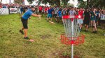 Paul McBeth throwing a frisbee into a net while playing disc golf