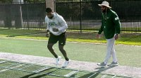 University of South Florida's Director of Football Strength and Conditioning AJ Artis Coaching An Athlete On Improving Agility with a Footwork Ladder Drill