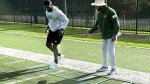 University of South Florida's Director of Football Strength and Conditioning AJ Artis Showing An Athlete His Footwork Ladder Drill for Agility