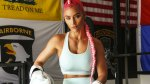 WWE female wrestler Natalie Eva Marie playing Jade on Paradise City doing boxing workout in a boxing ring wearing boxing gloves