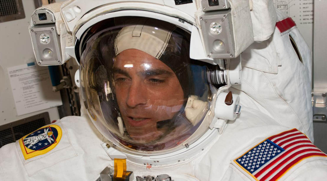Astronaut Chris Cassidy Wearing An American Astronaut Suit In Space