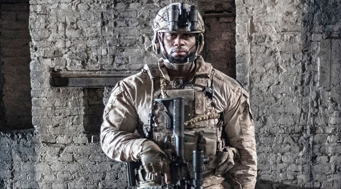 Celebrity Trainer and Former Special Ops Corey Calliet in Full Army Gear