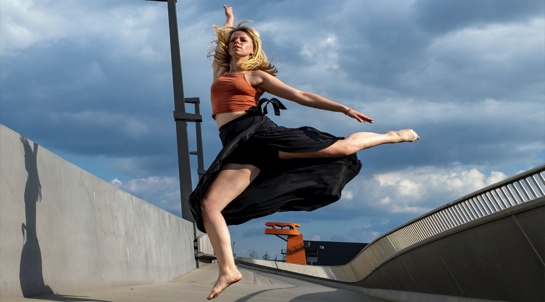 Female dancer performing a dance inspired bodyweight workout