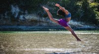 Female doing a dance inspired bodyweight workout in a lake