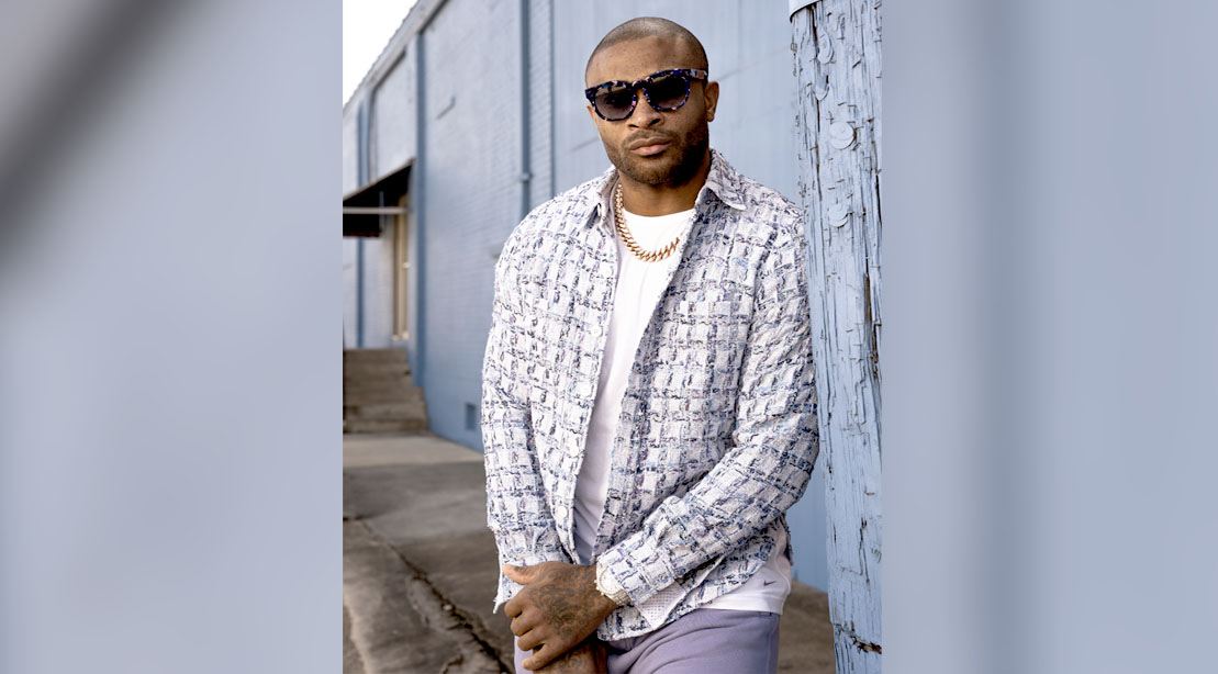P.J. Tucker Center for the Milwaukee Bucks posing out of unifrom