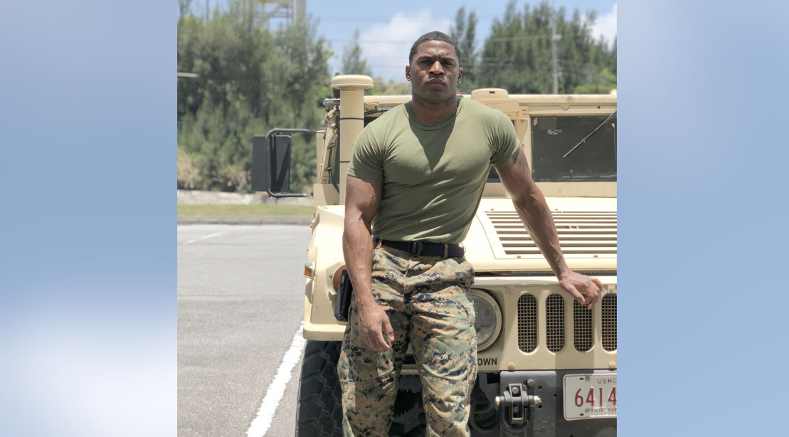 Aaron Marks standing next to a humvee ready for his 1000-reps workout