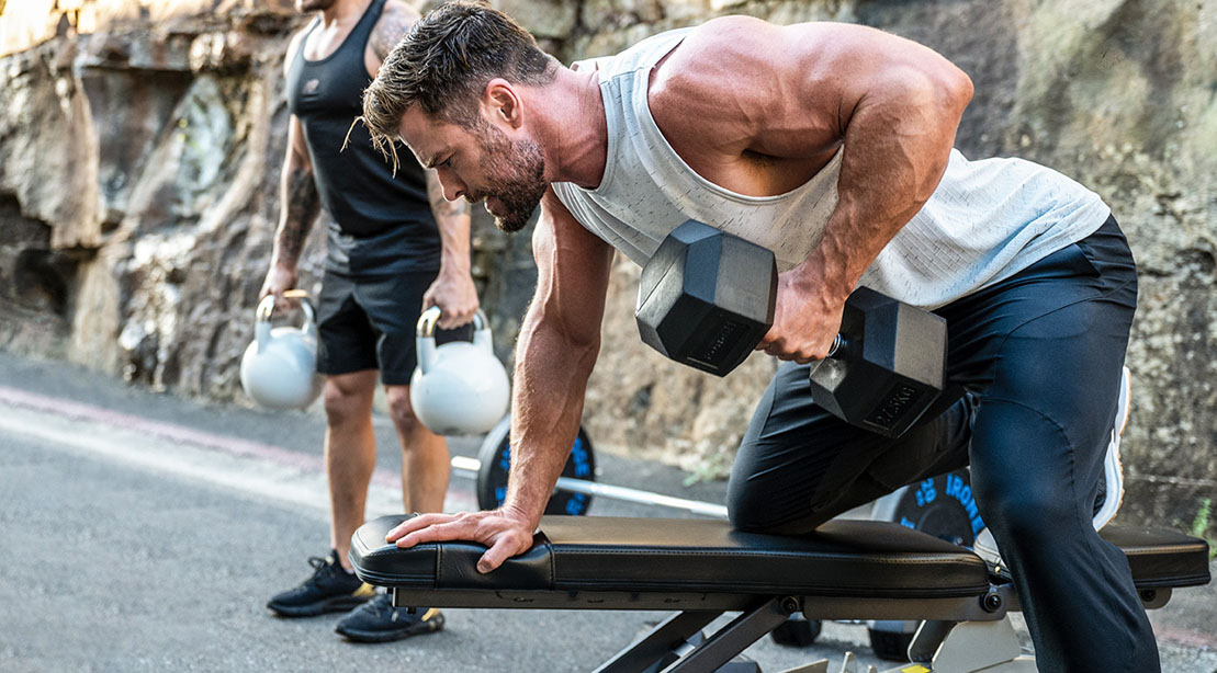 Actor and creater of the fitness app Centr Power App Chris Hemsworth working out with a dumbbell row exercise