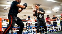 Boxing champ Gervonta Davis training in a boxing gym with his boxing trainer