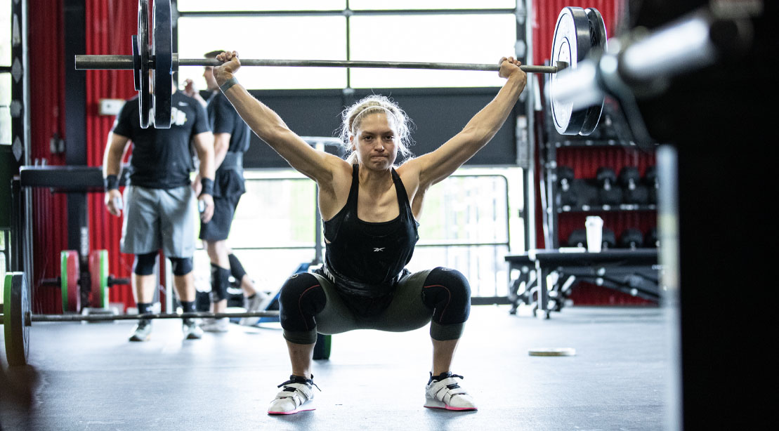 Crossfitter Haley Adams performing a overhead barbell squat