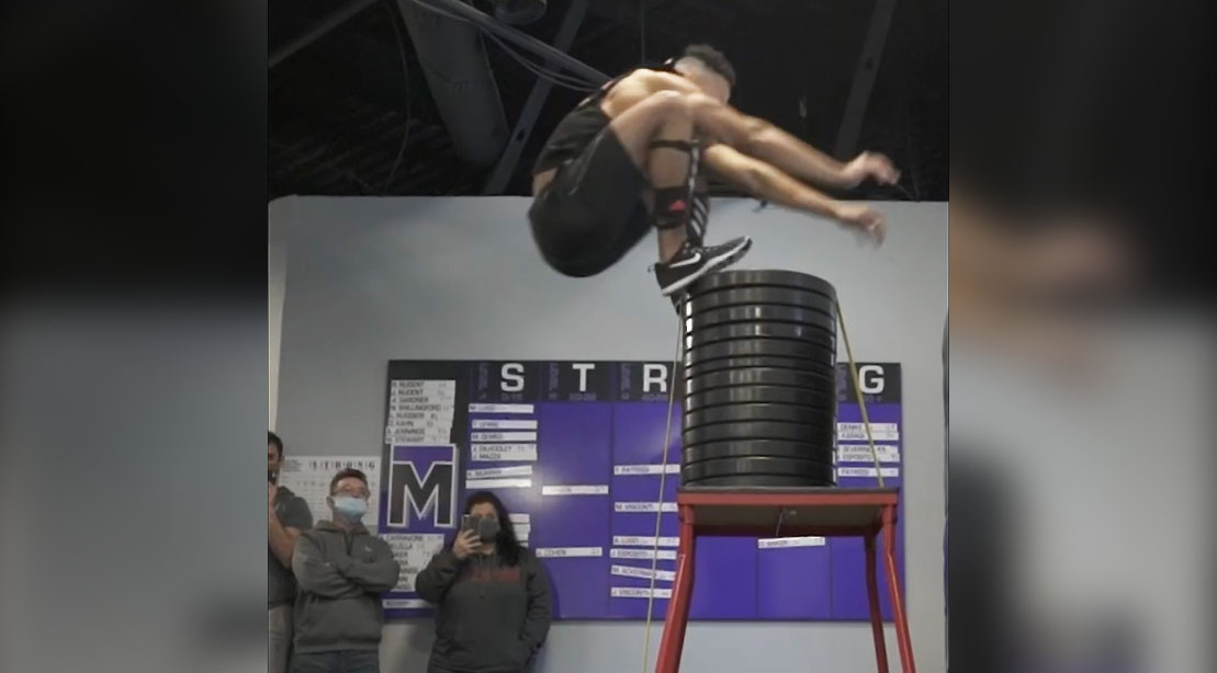Guiness World Record holder Christopher Spell holding performing his record high box jump