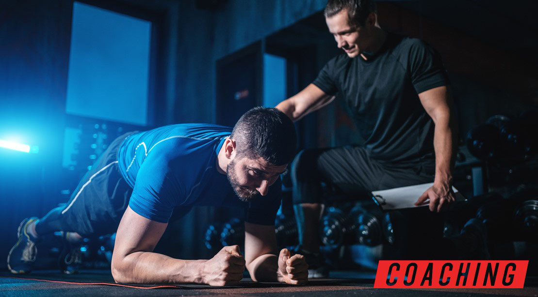 Muscle and fitness trainer coaching a person who wants to lose weight